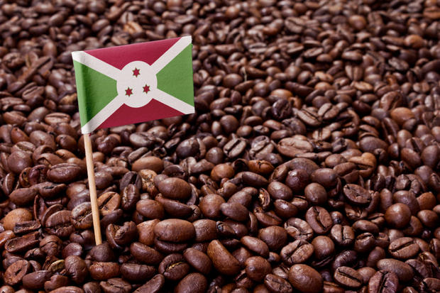 The flag of Burundi sticking in roasted coffee beans.(series)